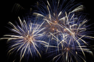 15795503 - blue colorful holiday fireworks on the black sky background.